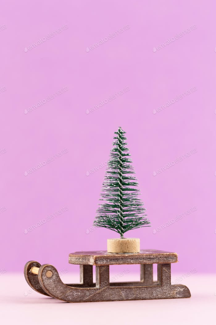 Christmas tree on pastel colored background. Christmas or New Year minimal concept.