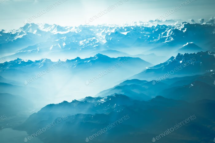 Mountain peak. landscape with peaks covered by snow and clouds