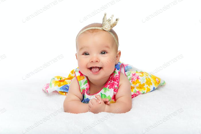 happy beautiful baby girl with crown on head