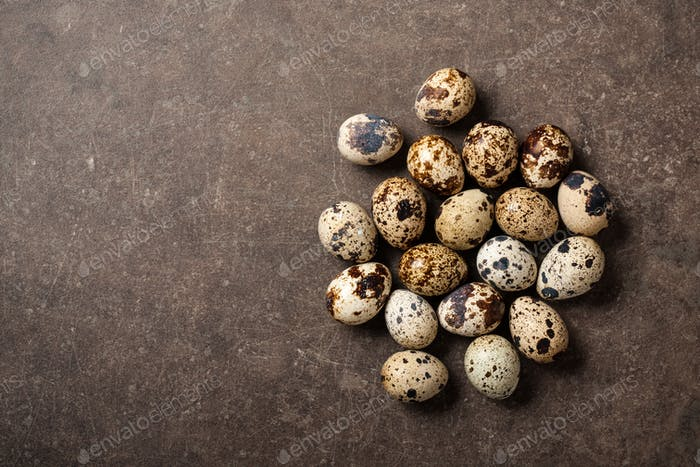 Quail eggs on stone table