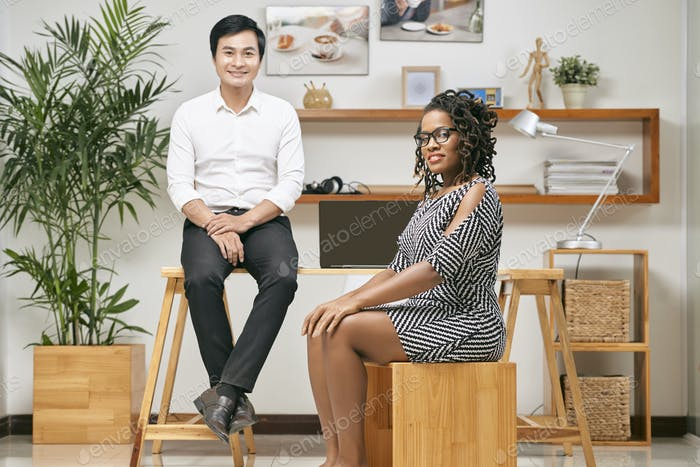 Business lady and businessman sitting