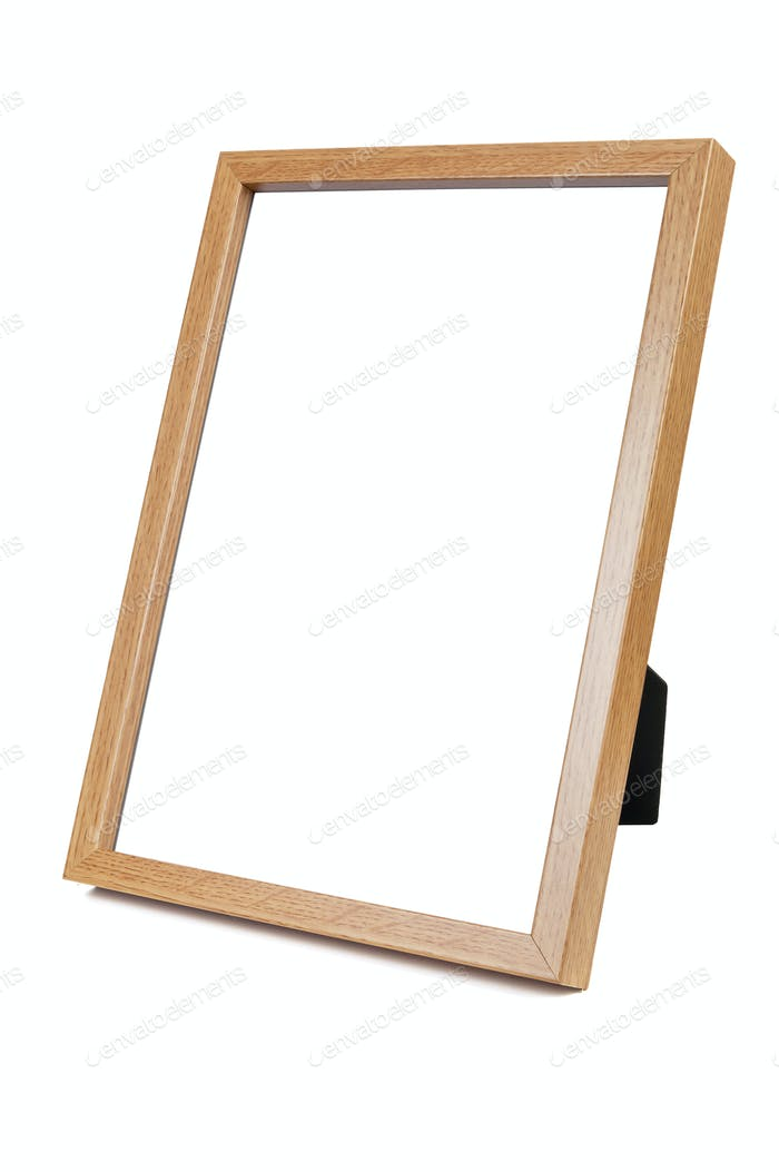 Wooden empty photo frame on white background