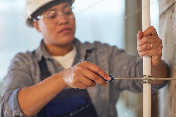 Female Plumber Working