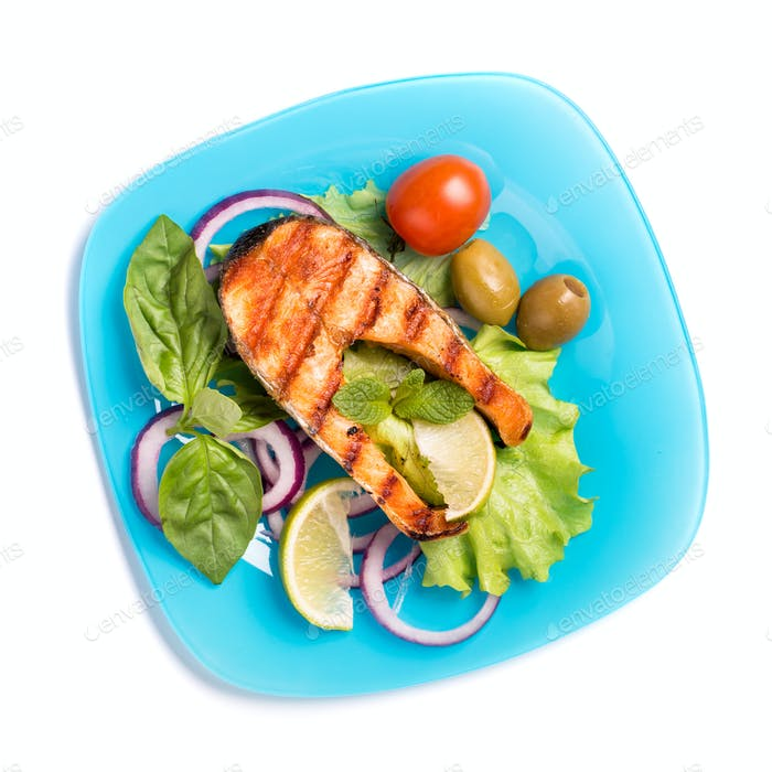 Grilled salmon on blue plate isolated