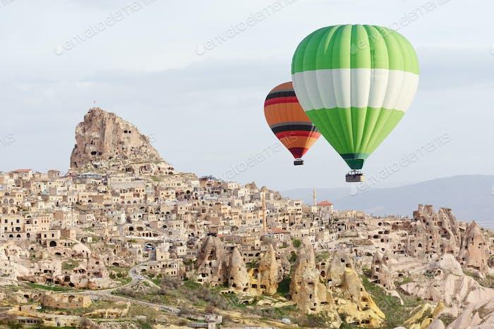 Balloons flight in the sunrise sky