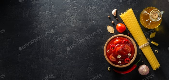 tomato sauce in bowl on black background