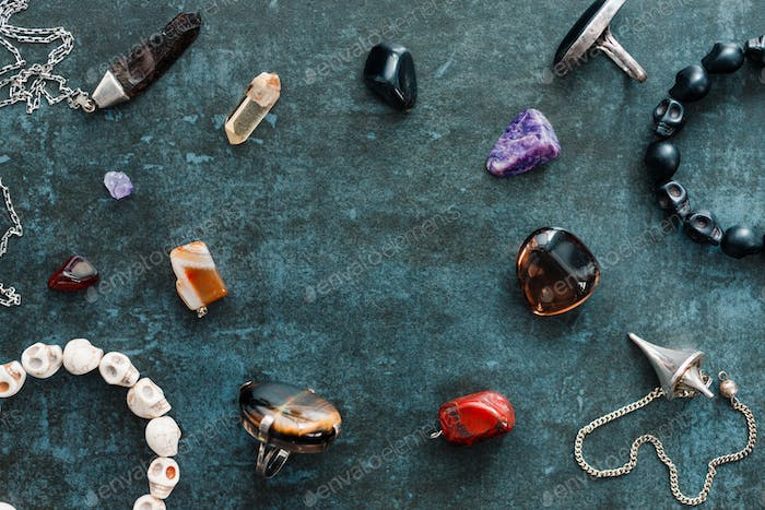 Magic flat lay. Various precious and semiprecious stones on a blue background for witchcraft.