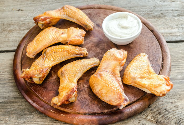 Smoked chicken wings with spicy sauce