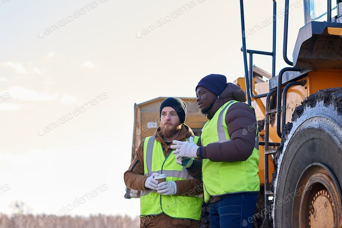 Two Tough Workers on Industrial Site Outdoors
