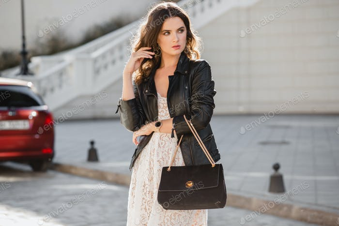 attractive woman walking in street in fashionable outfit
