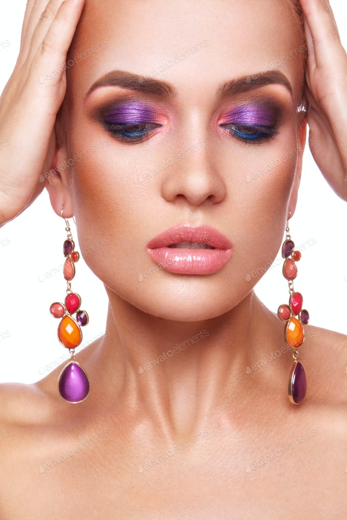 Beautiful woman with colored makeup.