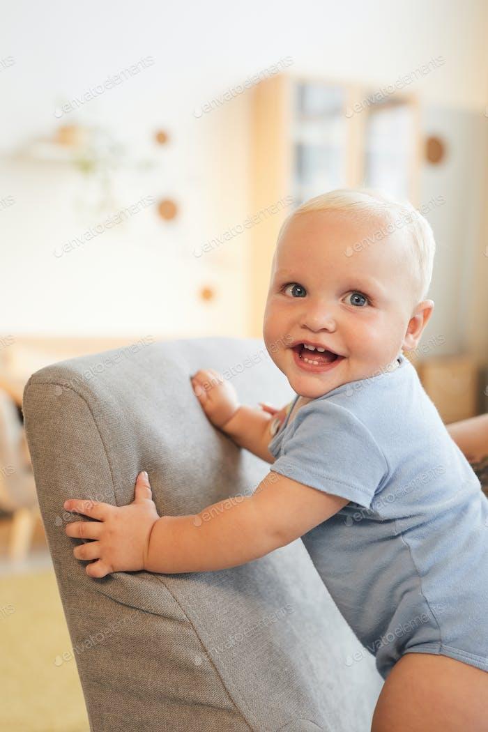 Cheerful Baby On Armchair
