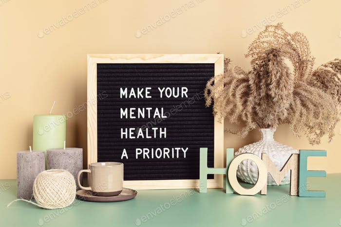 Make your mental health a priority motivational quote on the letter board. Inspiration psycological