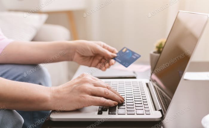 Senior woman hands shopping online at home