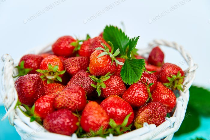Strawberries in white basket. Fresh strawberries. Beautiful strawberries.
