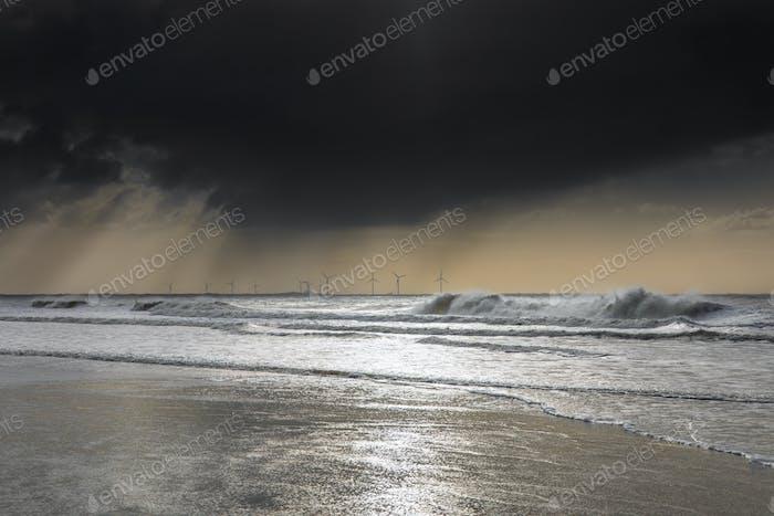 sunlight over stormy rainy North sea