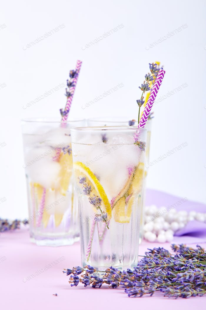 Thumbnail for Lavender lemonade with lemon and ice on purple background