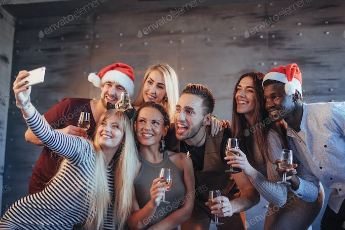Group beautiful young people doing selfie in the new year party, best friends girls and boys