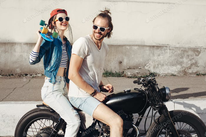 Young man and woman having fun on sunny day