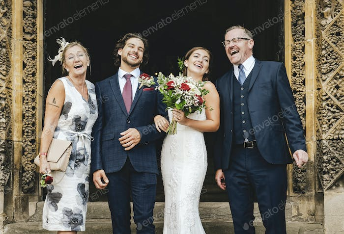Newly weds with their family outside of church