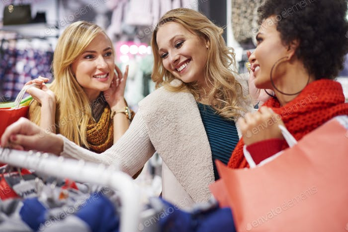 Women looking at clothes rack in the store