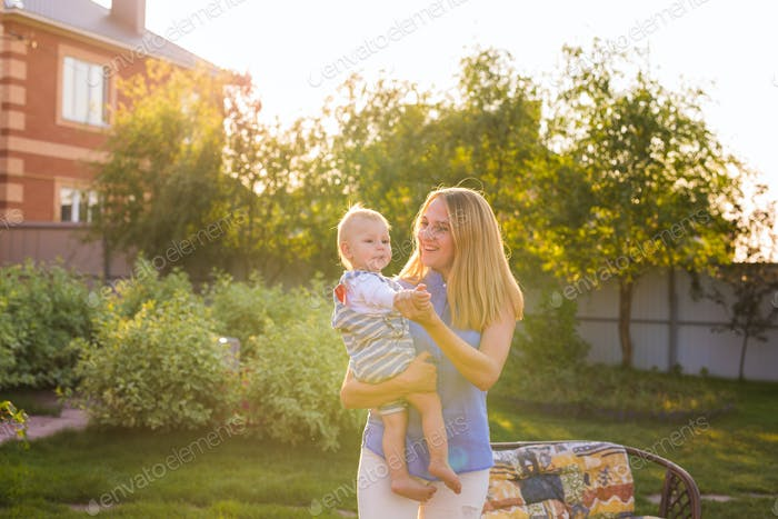 baby boy with his mum outdoors