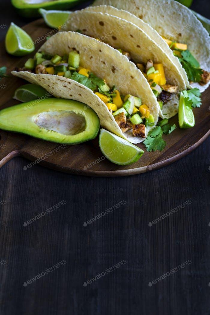 Chicken tacos with mango salsa background
