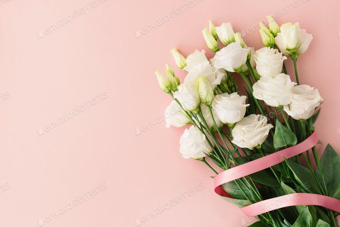 Bouquet of white roses with pink ribbon
