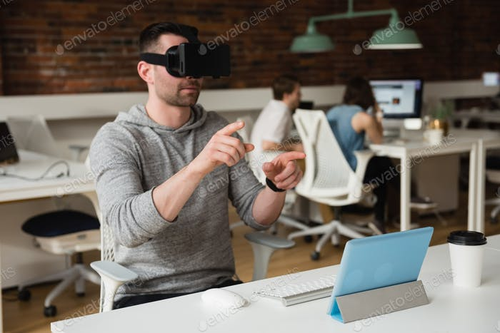 Male executive using virtual reality headset