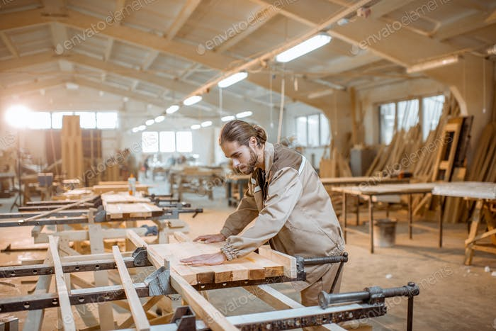 Carpenter working at the carpentry manufacturing