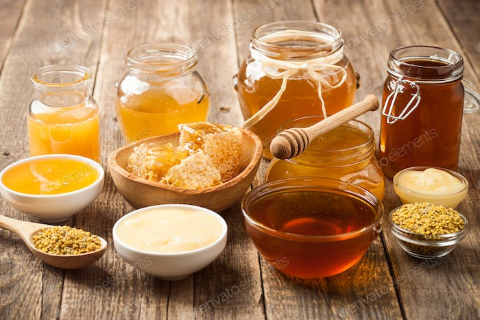 Various honey on wooden table
