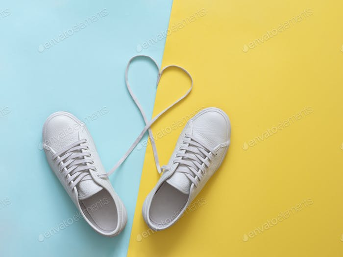 white sneakers with laces in heart shape
