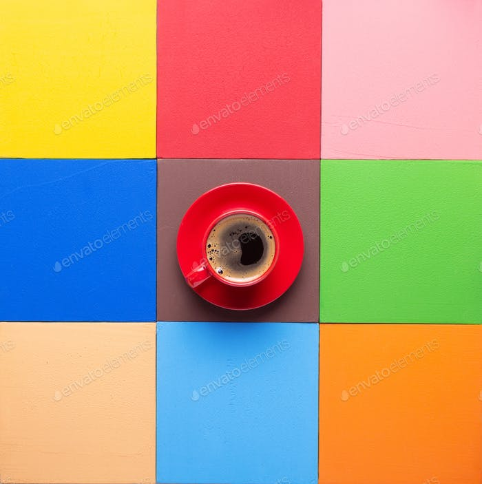 Cup of coffee at colorful abstract background