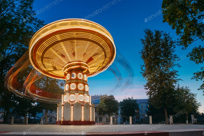 Illuminated Rotating High Speed Carousel Merry-Go-Round. Summer