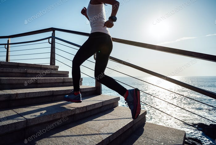 Running up on seaside stairs