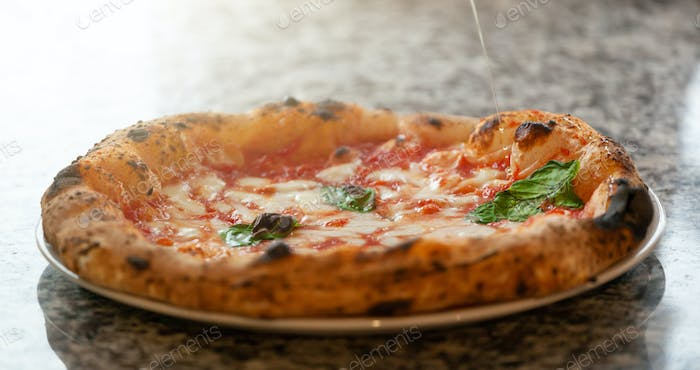 Olive oil wire on margherita pizza