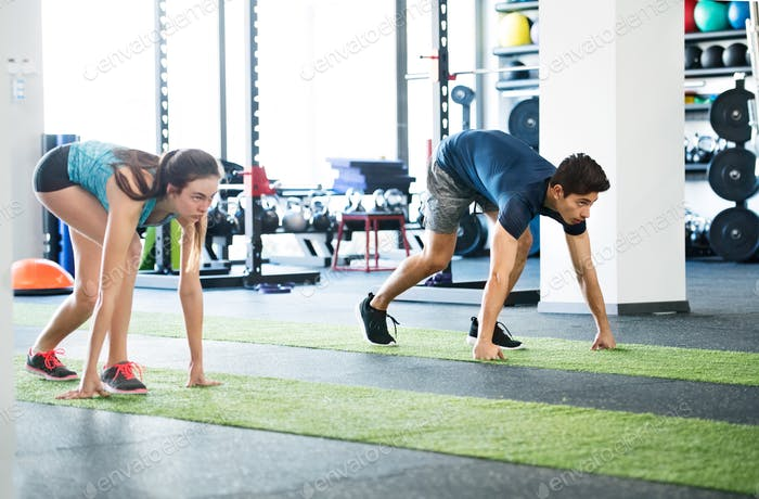 Runners in gym prepared for intense training session.