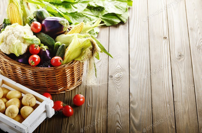 Basket of Organic vegetable food ingredients and crate of potato