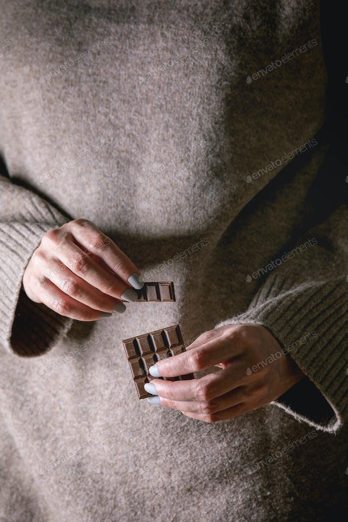 Dark chocolate in hands