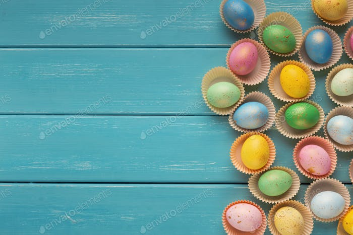 Easter background. Colored eggs, top view