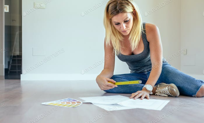Girl looking house plans