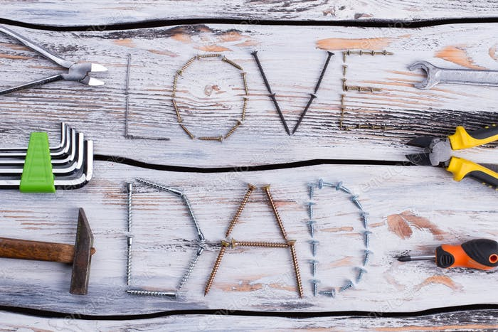 Inscription LOVE DAD made from metal screws and nails.