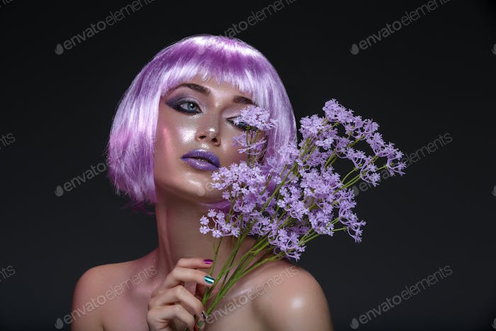 Beautiful girl in purple wig with flowers