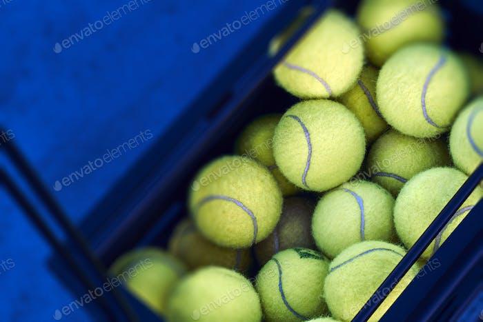 Black box with tennis balls on the floor