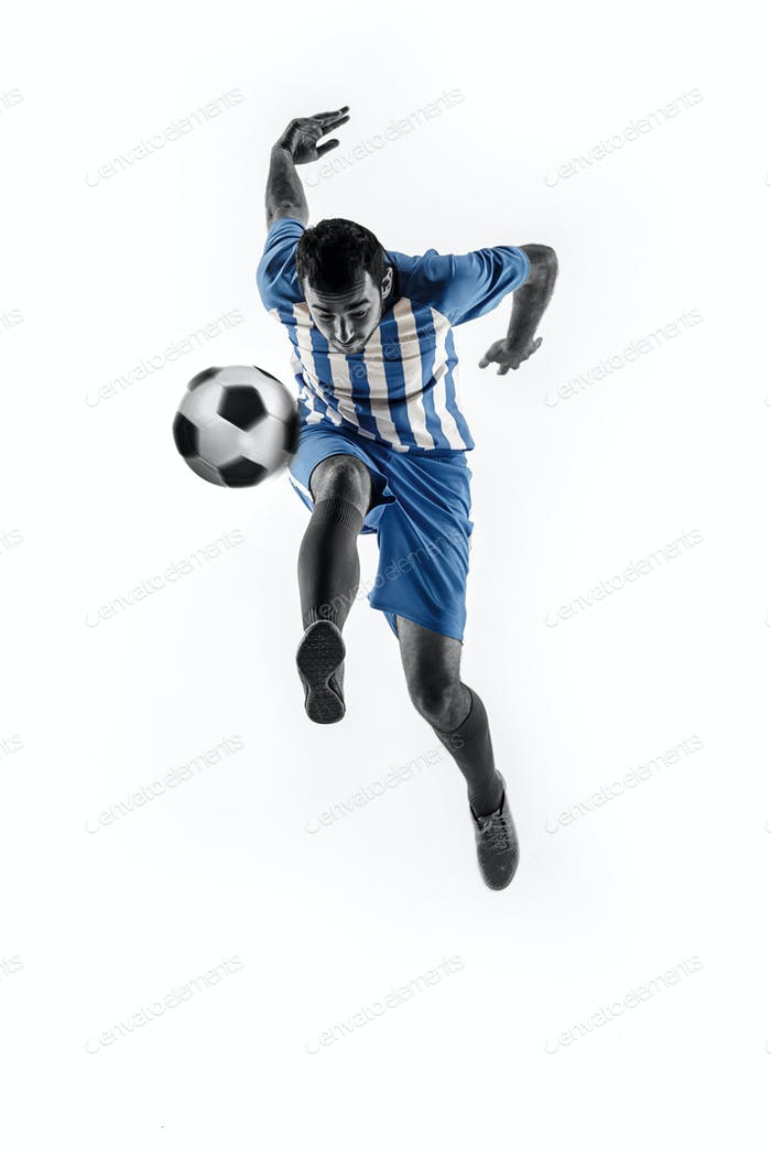 Professional football soccer player with ball isolated on white background