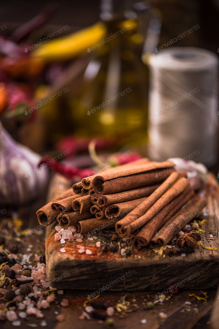 Whole cinnamon stocks on wooden boar. Spices concept