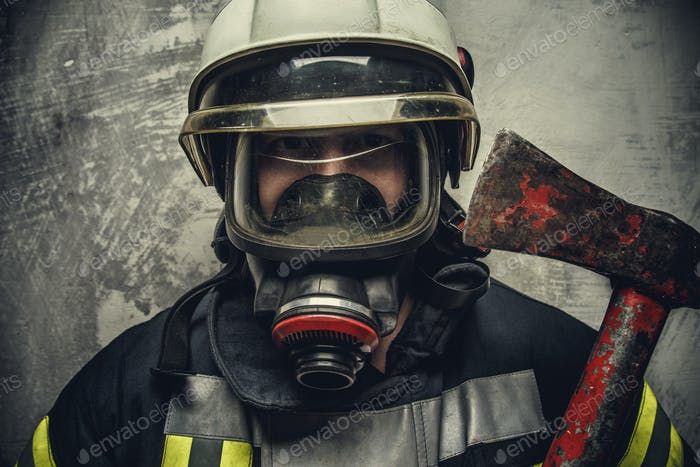 Portrait of firefighter in oxygen mask.