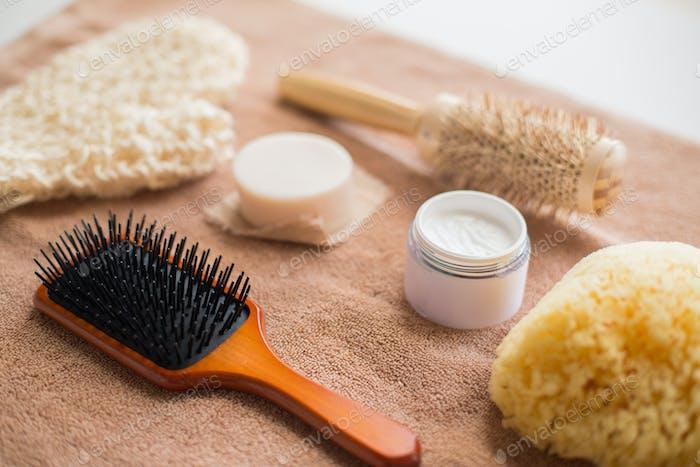 hair brush, cream, sponge, soap bar and bath towel