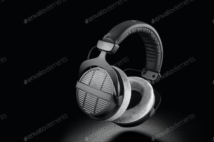 Professional over-ear headphones on black background