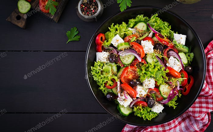 Greek salad with cucumber, tomato, sweet pepper, lettuce, red onion, feta cheese